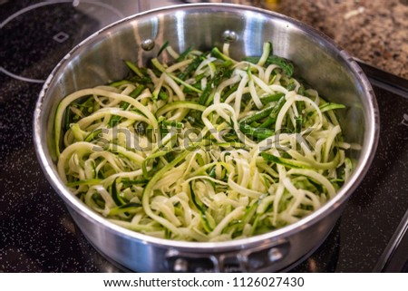 Zoodles zucchini noodles close up cooking pan frying peeled healthy gluten free vegan vegetarian green vegetable spaghetti