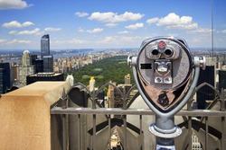 Zoom binoculars on Rockefeller Center with view on a Manhattan Central Park in NYC