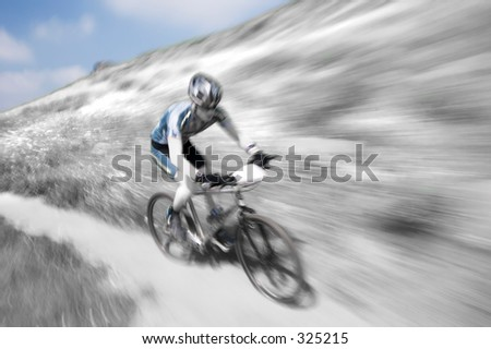 Zoom blur effect, in black and white, of a mountain bike racer