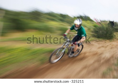 Zoom blur effect of a mountain bike racer