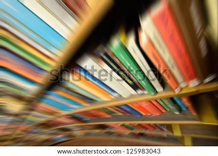 Zoom blurred bookshelf - stock photo