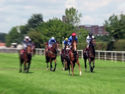 Zoom effect applied to horses running at York Race Course.