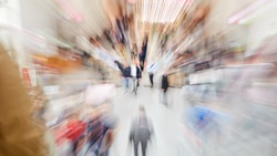 Zoom in on hectic people and people at a trade fair or in a pedestrian area