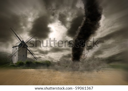 Zoom of a large tornado over a wind mill
