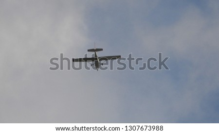 Zoom photo of single engine small airplane flying in the sky