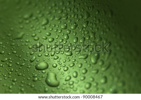 Zoomed drops on green wavy background making texture - stock photo