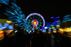 Zoomed Ferris wheel at Saint Catherine Place on Christmas market season in Brussels
