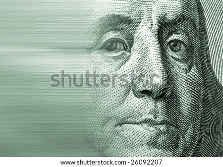 Zoomed to a particular note of a hundred U.S. dollars representing the face of Franklin with motion effect