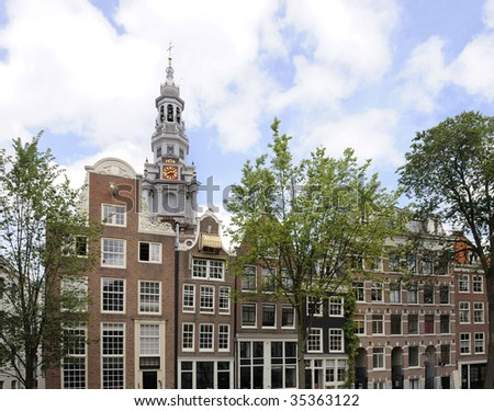 Zuidertower (South tower) and old houses at a Amsterdam canal
