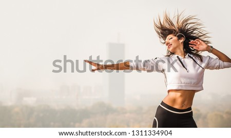 Zumba dance fitness instructor doing sport aerobic exercises. Motivational coach. Outdoor training