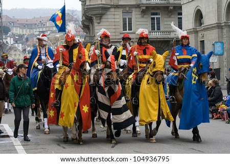 ZURICH - APRIL 16: Members of traditional annual spring parade of Guilds, symbolising end of the winter, on April 16, 2012 in Zurich.