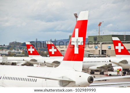 ZURICH - APRIL 22: SWISS's commercial air crafts at Zurich airport on April 22, 2012 in Zurich, Switzerland. Swiss International Air Lines (SWISS) was formed  after the 2002 bankruptcy of Swissair.