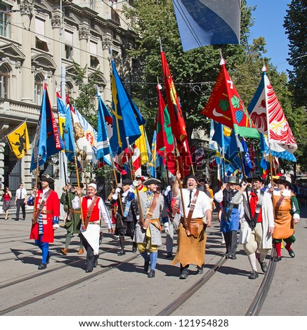 ZURICH - AUGUST 1: Swiss National Day parade on August 1, 2012 in Zurich, Switzerland. Representatives of professional guilds of city Zurich in a historical costumes taking part in parade.