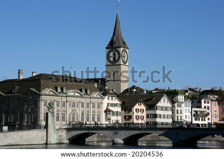 Zurich cityscape. St. Peter\'s Church tower with world\'s largest church clock face. Swiss city. Limmat river connecting with Lake Zurich.
