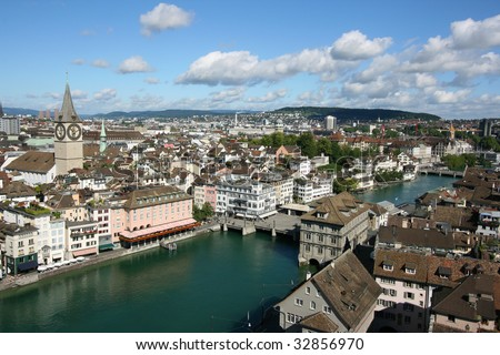 Zurich cityscape. St. Peter\'s Church tower with world\'s largest church clock face. Swiss city. Aerial view.