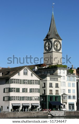 Zurich cityscape. St. Peter\'s Church tower with world\'s largest church clock face. Swiss city.