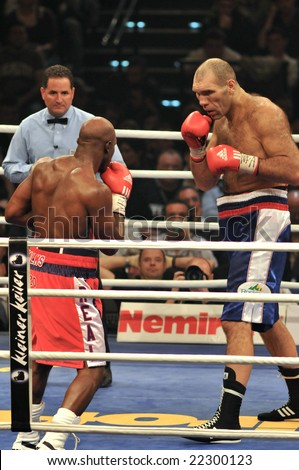 ZURICH - DECEMBER 20: Evander Holyfield (L) fights Nikolai Valuev (R) during the WBA Heavyweight Championship fight on December 20, 2008 in Zurich.  Holyfield lost the bout.