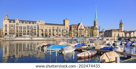 Zurich landmarks: the Lady Minster (German: Fraumunster), the St. Peter Church and the City Hall (German: Stadthaus)