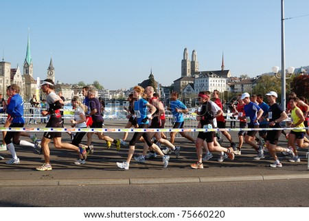 ZURICH, SWITZERLAND - APRIL 17: Group of runners runs the Zurich Marathon, April 17, 2011 in Zurich, Switzerland.