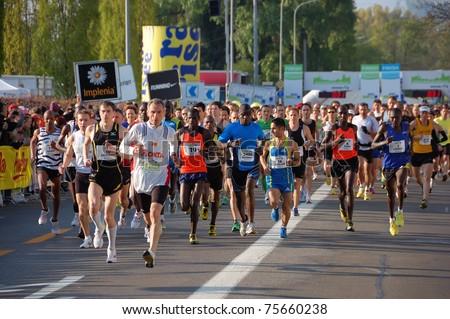 ZURICH, SWITZERLAND - APRIL 17: Group of runners starts the Zurich Marathon, April 17, 2011 in Zurich, Switzerland.