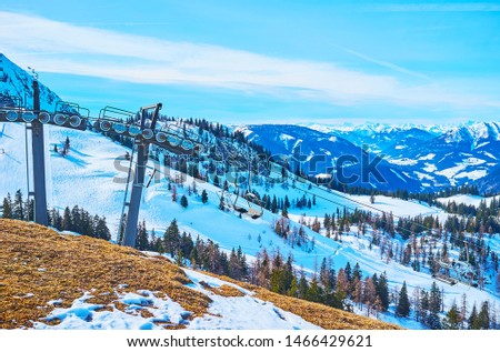 Zwieselalm mountain boasts good infrastructure with ski lifts, cableways and numerous routes for sportsmen, visiting it on different seasons, Gosau, Austria