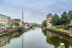 Zwolle, Netherlands - September 26, 2020: Citycentre of Zwolle with canals, old historic ships and houses and bridge.