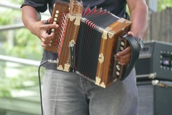 Zydeco Accordian player  entertains the crowd at the Waterfront Blues Festival, Portland, Oregon