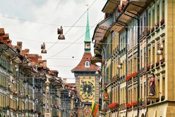 Zytglogge clock tower in Kramgasse street with shopping area in old city center of Bern, Switzerland