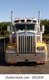 A stock photograph of an eighteen wheeler semi truck.