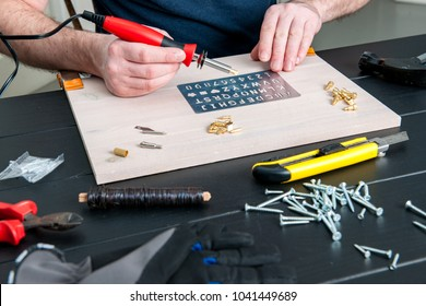 Stock picture of pyrography pen , tools and creative hobby work