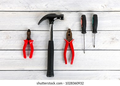 Stock picture of tools and screws on a wooden background