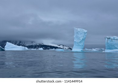 Stock pictures of ice on the ocean and mountains