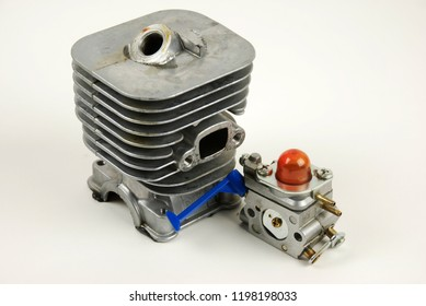 Stock pictures of a small gas engine and a carburetor