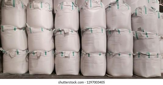 Stock pile jumbo-bag in warehouse waiting for shipment.