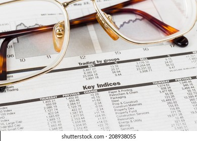 Stock price detail financial newspaper with glasses