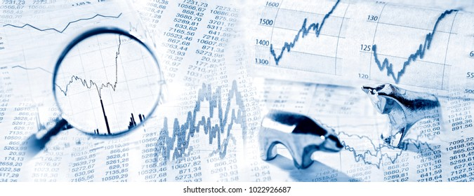 Stock quotes as chart and graph with magnifier and bull and bear