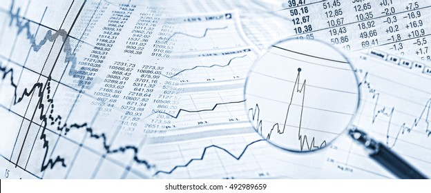 Stock quotes, price charts and a magnifying glass with stock price in detail.