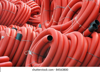 Stock red coiled plastic pipes