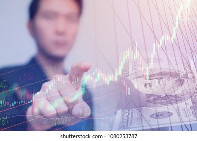 Stock trader businessman pointing finger to touch screen to buy sell decision point concept