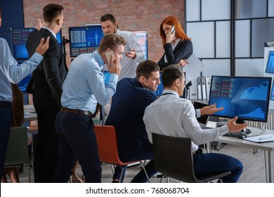 Stock traders working in office