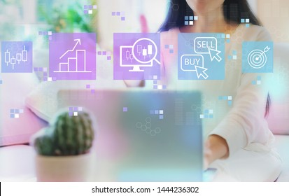 Stock trading concept with woman using her laptop in her home office