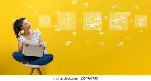 Stock trading concept with young woman using a laptop computer