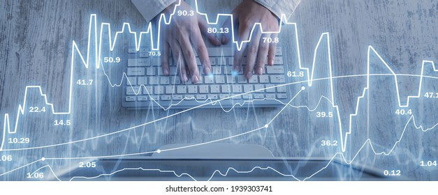 Stock trading. Human hands typing in computer keyboard. Financial stock market