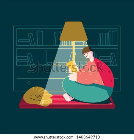 a man in a dark room reading a