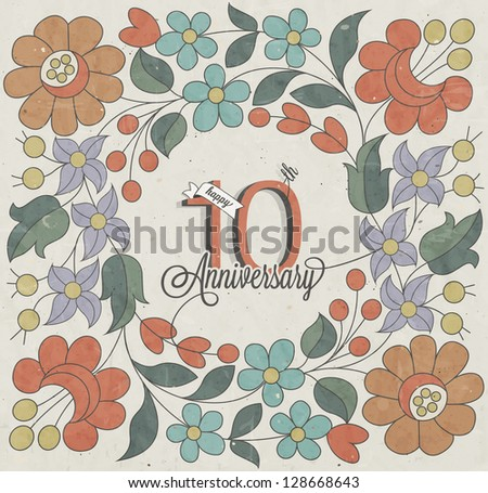 10 Anniversary. Vintage retro Ten anniversary design with floral background.  Flower elements for anniversary greeting. Hand lettering style typographic and calligraphic symbols for 10 anniversary.