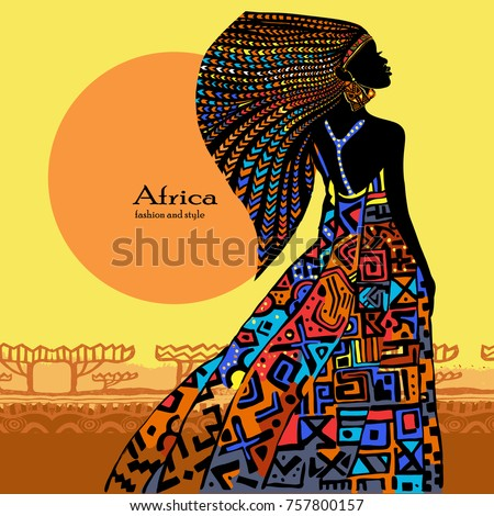 Beautiful African woman in a bright dress against the background of a conventional African landscape