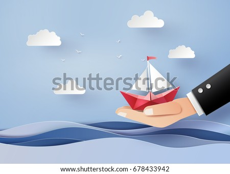 business concept of freedom and believe ,origami made paper sailing boat on hand. The illustrations do the same paper art and digital crafts style