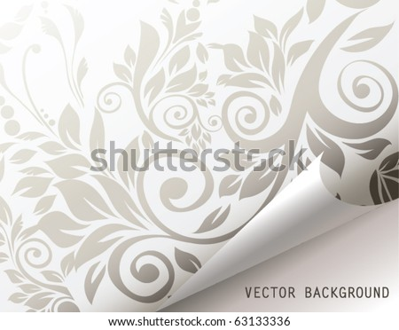 Curled corner of floral background page.