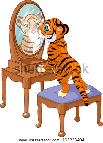 cute tiger cub looking in the