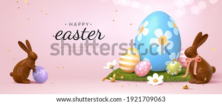 3d Easter banner with chocolate rabbits and beautiful painted eggs set on grass. Concept of Easter egg hunt or egg decorating art. Сток-фото ©